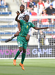 Sheldon Holder (9) of Guyana (in front) and Carlyle Mitchell (12) of Trinidad and Tobago leap for a header during their Gold Cup match on June 26, 2019 at Children's Mercy Park in Kansas City, KS.<br /> Tim VIZER/AFP