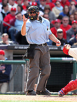 Home plate umpire Chris Guccione makes a call during the Philadelphia Phillies home opener against the Miami Marlins at Citizens Bank Park on April 9, 2012 in Philadelphia, Pennsylvania.  Miami defeated Philadelphia 6-2.  (Mike Janes/Four Seam Images)
