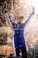 Apr 17, 2009; Avondale, AZ, USA; NASCAR Nationwide Series driver Greg Biffle celebrates after winning the Bashas Supermarkets 200 at Phoenix International Raceway. Mandatory Credit: Mark J. Rebilas-