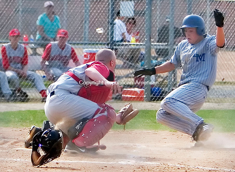 BURLINGTON, CT- 23 APRIL 07- 042307JT08-<br /> Wamogo pitcher Alex Santella makes an out as Lewis Mills' Colin Pisarski slides to home during Monday's game at Lewis Mills.<br /> Josalee Thrift Republican-American