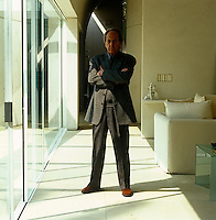 A portrait of architect Teodoro Gonzalez de Leon in the sitting room of his contemporary Mexican home