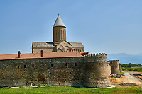 Pictures & images of the walls and medieval Alaverdi St George Cathedral & monastery complex, 11th century, near Telavi, Georgia (country). <br /> <br /> At 50 meters high Alaverdi St George Cathedral was once the highest cathedral in Georgia (now its the nes Tblisi cathedral). The cathedral is part of a Georgian Orthodox monastery founded by the monk Joseph [Abba] Alaverdeli, who came from Antioch and settled in Alaverdi. On the UNESCO World Heritage Site Tentative List.