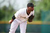 GCL Pirates relief pitcher Juan Henriquez (36) looks in for the sign during the first game of a doubleheader against the GCL Yankees East on July 31, 2018 at Pirate City Complex in Bradenton, Florida.  GCL Yankees East defeated GCL Pirates 2-0.  (Mike Janes/Four Seam Images)