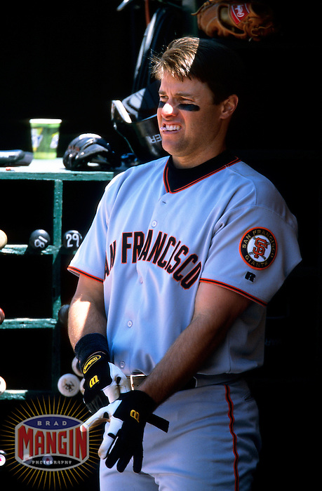 OAKLAND, CA - J.T. Snow of the San Francisco Giants gets ready to bat in the dugout during a game against the Oakland Athletics at the Oakland Coliseum in Oakland, California on June 4, 2000. Photo by Brad Mangin