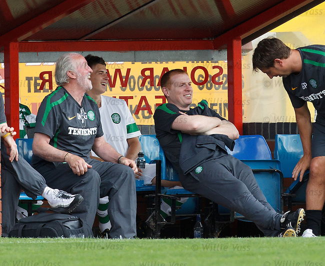 Neil Lennon having a laugh in the Celtic dugout with Danny McGrain and co