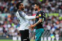 Tom Huddlestone of Derby County clashes with Borja Baston of Swansea City during the Sky Bet Championship match between Derby County and Swansea City at Pride Park Stadium in Derby, England, UK. Saturday 10 August 2019
