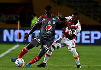 BOGOTA - COLOMBIA - 26 - 01 - 2018: Jose Moya (Der.) player de Independiente Santa Fe disputa el balón con Cristian Martinez Borja (Izq.) jugador de America de Cali, durante partido entre Independiente Santa Fe y America de Cali, por el Torneo Fox Sports 2018, jugado en el estadio Nemesio Camacho El Campin de la ciudad de Bogota. / Jose Moya (R) player of Independiente Santa Fe vies for the ball with Cristian Martinez Borja (L) player of America de Cali, during a match between Independiente Santa Fe y America de Cali, for the Fox Sports Tournament 2018, played at the Nemesio Camacho El Campin stadium in the city of Bogota. Photo: VizzorImage / Luis Ramirez / Staff.