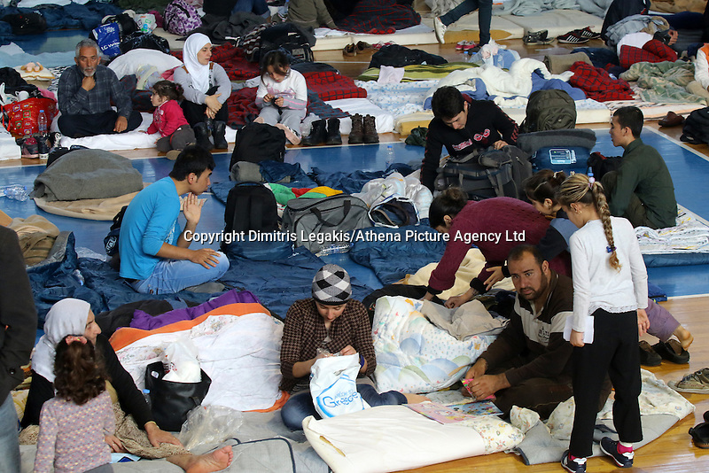 Pictured: Hundreds of migrants sleeping on the floor in Ierapetra basketball arena. Friday 28 November 2014<br />