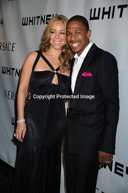 Mariah Carey in Versace dress and husband Nick Cannon.arriving at The Whitney Museum of American Art's Gala on October 20, 2008 at The Whitney Museum in New York City. ..Robin Platzer, Twin Images