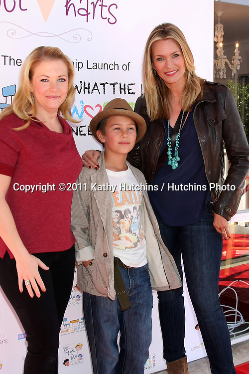 "LOS ANGELES - NOV 5:  Melissa Joan Hart, Natasha Henstridge and son Asher arrives at the ""YOU AND ME"" Book Party at SweetHarts on November 5, 2011 in Sherman Oaks, CA"