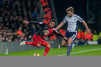 WEST BROMWICH, ENGLAND - FEBRUARY 11: Kyle Naughton of Swansea City keeps the ball in under pressure from James Morrison of West Bromwich Albion   during the Premier League match between West Bromwich Albion and Swansea City at The Hawthorns on February 11, 2015 in West Bromwich, England. (Photo by Athena Pictures/Getty Images)