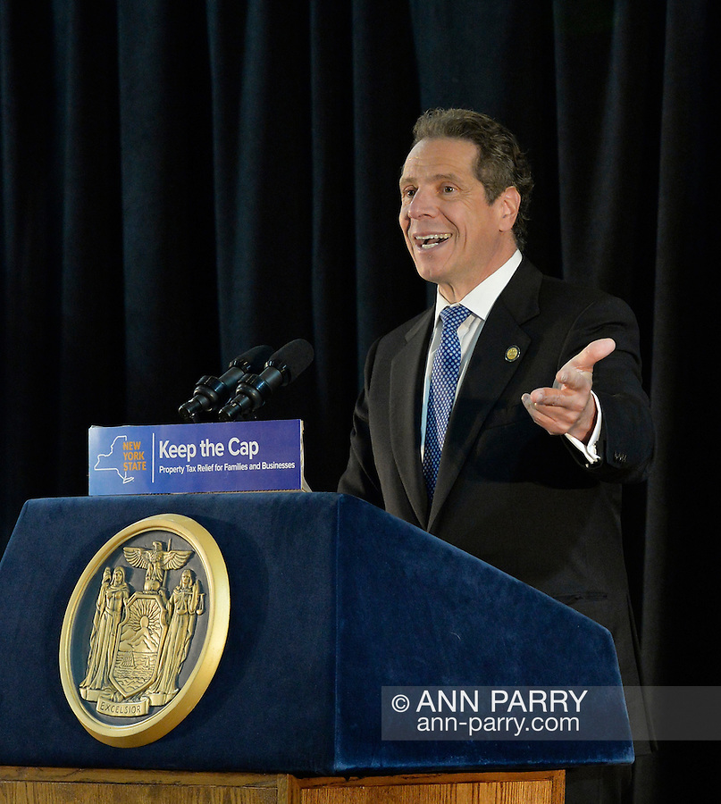 Seaford, New York, USA. 3rd June 2015. New York State Governor ANDREW CUOMO speaks at an event in support of extending the NY Property Tax Cap. At the bi-partisan event at Knights of Columbus Hall, over a hundred area residents and officials urged an extension of the property tax cap before the state legislative session ends on June 17. The NY Property Tax Cap is set to expire June 2016, but is legally linked to NYC rent-control regulations set to expire this month. In June 2011 in Nassau County, the governor signed the first property tax cap law. Podium has The Great Seal of New York and sign with message: Keep the Cap, Property Tax Relief for Families and Businesses.