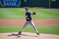 Troy Marks (32) of the Reno Aces delivers a pitch to the plate against the Salt Lake Bees in Pacific Coast League action at Smith's Ballpark on May 10, 2015 in Salt Lake City, Utah. Reno defeated Salt Lake 11-2 in Game Two of the double-header.  (Stephen Smith/Four Seam Images)