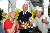 Tuesday May 13th 2014: REPRO  : Mullingar food producer and Chocolatier Olivia Curran and Artie Clifford, Chairman tempt Minister for Agriculture, Marine and Food Simon Coveney with her edible chocolate hat in St. Stephen's Green Dublin on Tuesday morning prior to the launch of the annual Blas na h-Eireann / Irish Food Awards which take place in Dingle County Kerry. <br /> A survey of Irish food producers has found that 70% of small to medium sized producers feel that a lack of financial advice and support is the biggest challenge they face in growing their businesses. The survey, conducted on behalf of the Blas na hEireann, Irish Food Awards, also found that for 65% of producers distribution is a major problem; not only nationally but also internationally.<br /> <br /> The findings of this survey, titled &ldquo;Producer Power in 2014&rsquo;, were announced at the launch of the 7thAnnual  Blas na hEireann 2014 Awards, which took place at The Westbury Hotel, Dublin, on Tuesday 13 May, where Minister Simon Coveney, a former producer himself, made the opening address.<br /> <br /> The Blas na hEireann, Irish Food Awards accreditation is the largest competition of its kind in Ireland attracting over 2,000 entries annually. It was set up to reward and support the best of Irish produce and the passionate, talented producers behind it. Award winners get to display the Blas na hEireann symbol on their products which previous, independent research shows leads to an increase in sales.  All entries are blind tasted by a team of over 350 judges in two tranches, including top chefs, journalists, industry experts, inspired home cooks and academics.  The judging system was developed and is overseen each year by Dr Joe Kerry and his team from the School of Food and Nutritional Science at UCC.   The Award winners in over 80 food categories will be presented at an Awards Ceremony in Dingle, Co Kerry on Saturday 4 October, to co-incide with the peninsula's hugely popular food and wine festival.  In addition Bord Bia spons