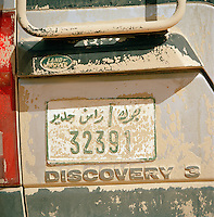 Detail of Libyian number plate covered in sand, Sahara Desert, Libya