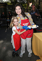 Los Angeles, CA - NOVEMBER 23: Mckenna Grace, Merit Leighton, At Los Angeles Mission Thanksgiving Meal For The Homeless At Los Angeles Mission, California on November 23, 2016. Credit: Faye Sadou/MediaPunch