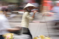 Hanoi<br /> , Vietnam - 2007 File Photo -<br /> <br /> <br /> A woman carrying bananas walk in a street of hanoi, in an artistic motion blur effect<br /> <br /> <br /> photo : James Wong-  Images Distribution