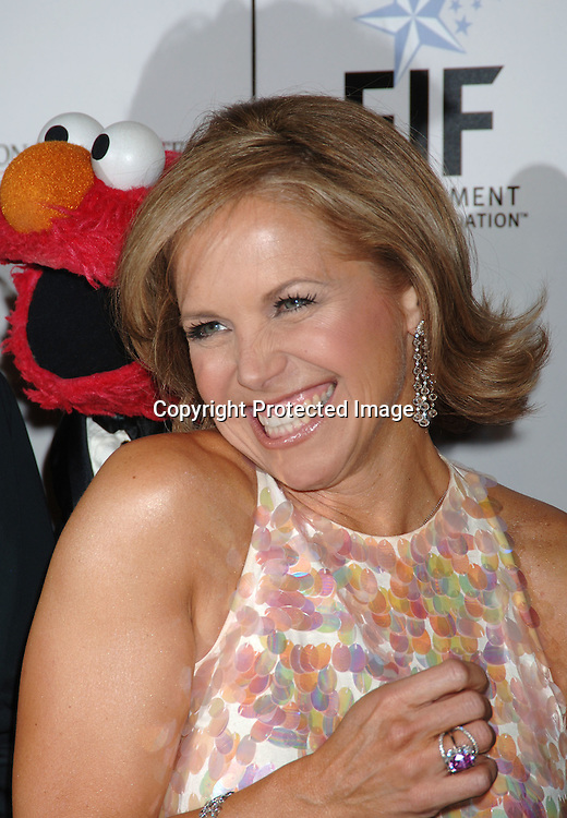 Elmo, Katie Couric..at The Entertainment Industry Foundation National Colorectal Cancer Research Alliance and The Jay Monahan Center for Gastrointestinal Health Hollywood Meets Motown Benefit on March 15, 2006 at The Waldorf Astoria Hotel. ..Robin Platzer, Twin Images