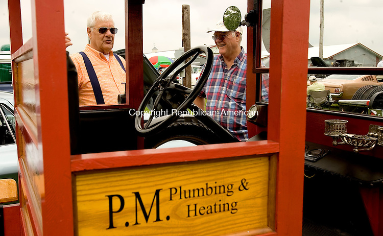 BETHLEHEM, CT- 06 JULY 2008 --070608JS02-Paul Molzon of Bethlehem, left, shows off his 1920 Model T to Ken Barker of Cheshire on Sunday during the Bethlehem Volunteer Fire Department's 9th annual car show at the Bethlehem Fairgrounds. Barker was at the show with his 1974 Rolls Royce Silver Shadow. <br /> Jim Shannon / Republican-American