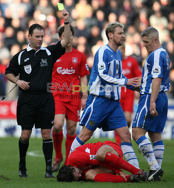 Pix by JOHN CLIFTON/SWpix.com -  Barclays Premiership, Wigan Athletic v Liverpool, The JJB Stadium, Wigan, 11/02/06..Picture Copyright >> Simon Wilkinson >> 07811267706..Wigan's Stephane Henchoz is booked by ref Rob Styles for his challenge on Liverpool's Fernando Morientes