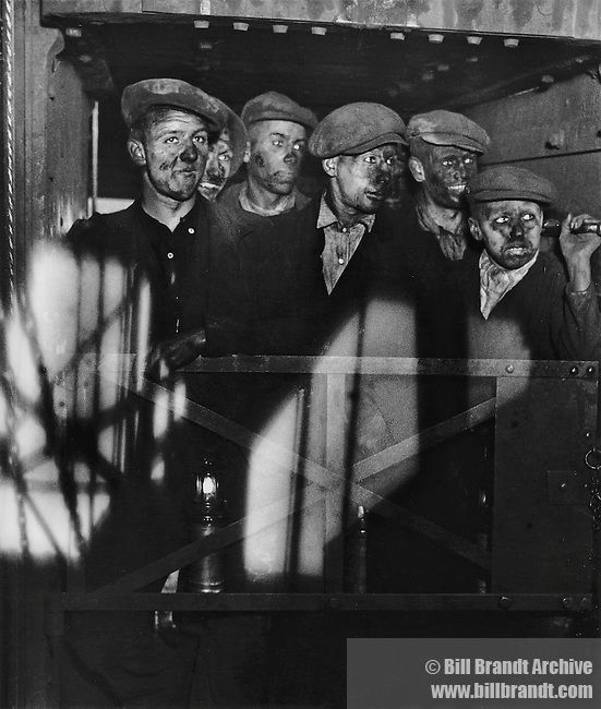 Miners returning to daylight, South Wales 1936 in the 'cage'.
