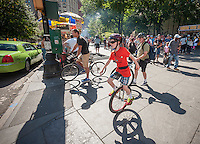 A  young unicyclist waits to start the 13-mile ride across the Brooklyn Bridge to Coney Island on Friday, August 29, 2014 as part of the NYC Unicycle Festival. The convergence of unicyclists was the start of the 3-day Fifth Annual New York City Unicycle Festival which besides the ride, features performances, classes and just plain fun with events happening on Governor's Island. (© Richard B. Levine)