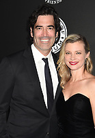 SANTA MONICA, CA - JANUARY 06: TV personality/model Carter Oosterhouse (L) and actress Amy Smart arrive at the The Art Of Elysium's 11th Annual Celebration - Heaven at Barker Hangar on January 6, 2018 in Santa Monica, California.<br /> CAP/ROT/TM<br /> &copy;TM/ROT/Capital Pictures