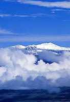 Snow capped mauna kea volcano with observatories.