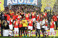 BOGOTA, COLOMBIA - January- 29-2017:  Players of Independiente Santa Fe  raise the championship trophy of the National League Aguila 2017  celebrate their  victory against of Independiente Medellin and win the National Super League Aguila 2017 during a match between Independiente Santa Fe and Independiente Medellin as part of National Super League Aguila 2017 match played  at Nemesio  Camacho El Campin Stadium on January 29, 2016 in Bogota, Colombia.   Photo by Felipe Caicedo/ VizzorImage / Staff