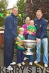SICK: Colette Jensen who was deleighted as Seamus Scannell and Michael Quirke called to her home in Currow on Thursday to with the Sam Maguire Cup as her children were suffering from the flu Adam and Eric Jensen...