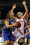 VERMILLION, SD, APRIL 2:  Taylor Gradinjan #24 from Florida Gulf Coast takes the ball to the basket against Kelly Stewart #15 from the University of South Dakota during the WNIT Championship game Saturday afternoon at the Dakota Dome in Vermillion, S.D. (Photo by Dave Eggen/Inertia)