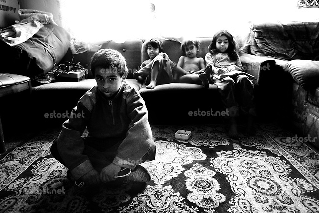 SERBIA, Belgrade, Oct. 15, 2006..A gypsy family sit in thair home located in an isolated ghetto-like settlement on outskirts of Belgrade, Serbia, Monday, Oct. 15, 2006. The Smaili family fled Kosovo in 1999 and are now living in a ghetto among 36 other families without electricity or water. The status of the Serbian southern province still remains unresolved while Serbia is woating on a public referendum for new Serbian constitution. © Djordje Jovanovic /EST&OST