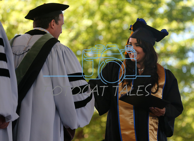 Regents graduate Lorena Cedano at the 2013 Western Nevada College Commencement at the Pony Express Pavilion, in Carson City, Nev., on Monday, May 20, 2013. .Photo by Cathleen Allison
