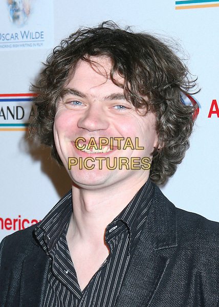 SJ McCARDLE.Oscar Wilde, US-Ireland Alliance reception celebrating Irish writing in film, Hollywood, California, USA.. .March 2nd, 2006.Photo: Byron Purvis/AdMedia/Capital Pictures.Ref: BP/ADM.headshot portrait smiling gap teeth.www.capitalpictures.com.sales@capitalpictures.com.© Capital Pictures.