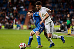 Real Madrid's Marco Asensio fight for the ball during Copa del Rey match between Real Madrid and UD Melilla at Santiago Bernabeu Stadium in Madrid, Spain. December 06, 2018. (ALTERPHOTOS/A. Perez Meca)