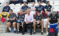 Keith Curle, Manager of Northampton Town, his team and bench during Colchester United vs Northampton Town, Sky Bet EFL League 2 Football at the JobServe Community Stadium on 24th August 2019