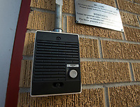 NWA Democrat-Gazette/BEN GOFF @NWABENGOFF<br /> An intercom mounted next to the main entrance Friday, March 9, 2018, at Lowell Elementary is used, allong with security cameras, to admit guests to the school.
