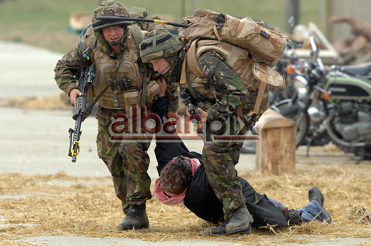 Troops from the Royal Welsh infantry  being put through their paces in the army's new Afghan villiage training complex deep in the Thetford forest.