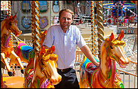 BNPS.co.uk (01202 558833)<br /> Pic: PhilYeomans/BNPS<br /> <br /> Bournemouth seafront funfair manager Joseph Abbott - has 'never seen so many people in his life'.<br /> <br /> The summer heatwave is leading to a 'bumper year' for tourism at Britain's premier seaside resort.<br /> <br /> Over 100,000 people are visiting Bournemouth, Dorset, every weekend and hotels are full to capacity, with restaurants packed and huge queues at ice cream stalls.<br /> <br /> Seafront kiosks are selling out of parasols and sun cream, while one bike hire company has reported a 50 per cent increase in business.