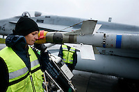 Ground crew working on Spanish F/A-18 Hornet. BOLD AVENGER 2007 (BAR 07), a NATO  air exercise at Ørland Main Air Station, Norway. BAR 07 involved air forces from 13 NATO member nations: Belgium, Canada, the Czech Republic, France, Germany, Greece, Norway, Poland, Romania, Spain, Turkey, the United Kingdom and the United States of America. The exercise was designed to provide training for units in tactical air operations, involving over 100 aircraft, including combat, tanker and airborne early warning aircraft and about 1,450 personnel.