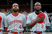 Chattanooga Lookouts Narciso Crook (4) and Carlten Daal (3) during the national anthem before a Southern League game against the Birmingham Barons on May 2, 2019 at Regions Field in Birmingham, Alabama.  Birmingham defeated Chattanooga 4-2.  (Mike Janes/Four Seam Images)