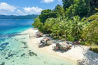 local fishermen shacks on a beach in Alyui Bay, Raja Ampat Islands, West Papua, Indonesia, Pacific Ocean