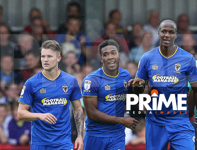 Dominic Poleon (centre) of AFC Wimbledon celebrates scoring the winning goal during the Sky Bet League 1 match between AFC Wimbledon and Chesterfield at the Cherry Red Records Stadium, Kingston, England on 3 September 2016. Photo by Andy Rowland / PRiME Media Images.