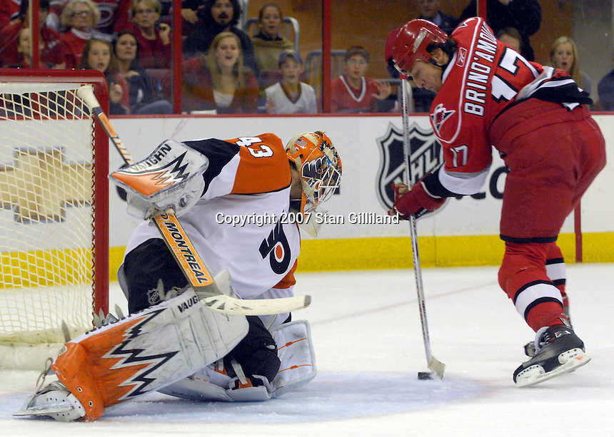 The Philadelphia Flyers' goalie Martin Biron makes a save against the Carolina Hurricanes' Rod Brind'Amour (17) during their game Wednesday, Nov. 21, 2007 in Raleigh, NC. The Flyers won 6-3.