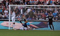 Pictured: Neil Taylor of Swansea (C in white) is suffering an injury from Peter Odemwingie of West Bromwich Albion (IN BLUE). Saturday 17 September 2011<br /> Re: Premiership football Swansea City FC v West Bromwich Albion at the Liberty Stadium, south Wales.