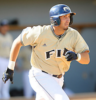 2 March 2008: Florida International third baseman Jorge Castillo (26) runs to first on his way to a double in the bottom of the seventh inning of the FIU 8-3 victory over Wagner  at University Park Stadium in Miami, Florida.