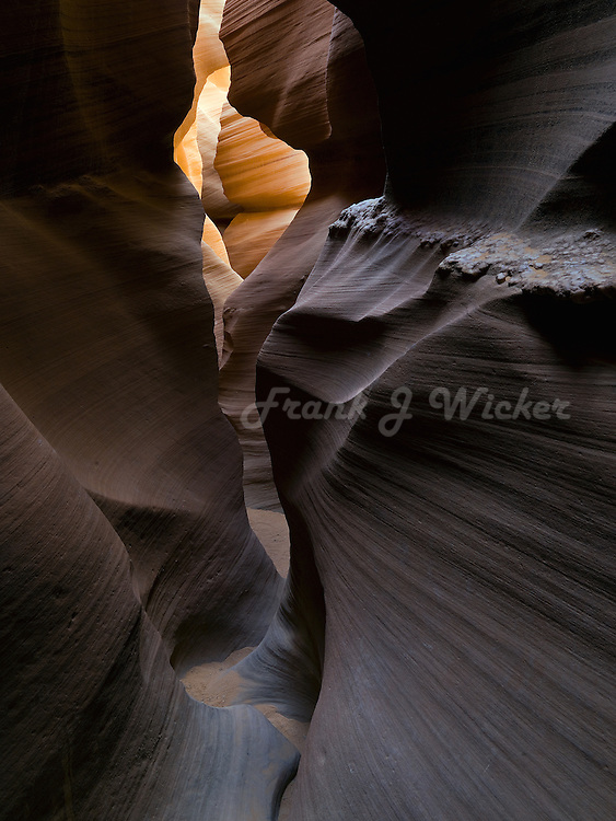 Narrow hiling path winds through the sandstone sculptures in the Antelope slot canyon of Arizona on the Colorado Plateau near Lake Powell and Page