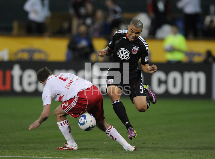 DC United forward Charlie Davies (9) goes against New York Red Bulls defender Stephen Keel (22) .  The New York Red Bulls defeated DC United 4-0, at RFK Stadium, Thursday April 21, 2011.