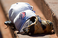 A patriotic Charlotte Knights cap sits on top of a glove in the home dugout at Knights Stadium July 5, 2010, in Fort Mill, South Carolina.  Photo by Brian Westerholt / Four Seam Images