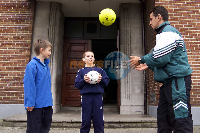 Brazilian International Cassiano Costa with Steven McGowan, Five Oaks and Aaron Goring, Cherrybrook at the Samba Soccer Summer Camp in St. Mary's Boys School, Congress Avenue..Picture: Paul Mohan/Newsfile